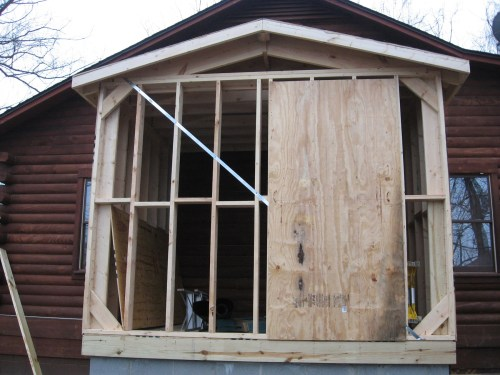 Project: Adding Closets to the log cabin - The first sheet of plywood after the closet was framed.