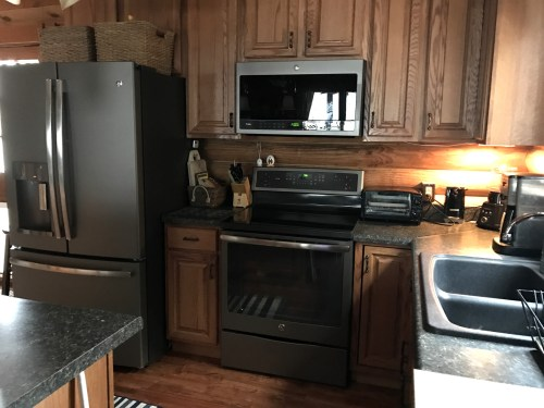 Planning the Log Cabin Kitchen: Even in a small kitchen, it is important to have some counter space on both sides of the stove and sink.