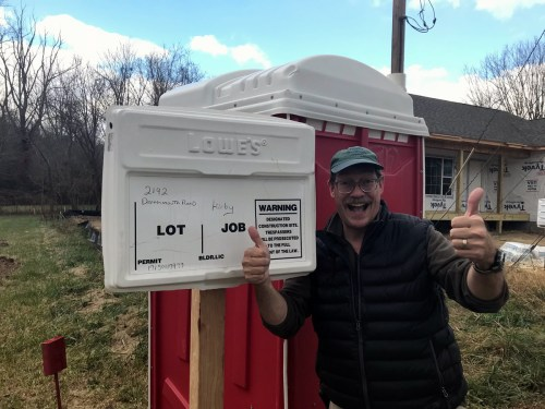 Building Our New Schumacher Home: A porta-potty was delivered and we got a permit box with our address and the house plans.