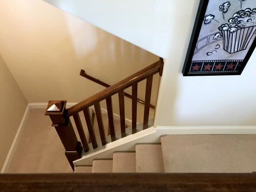 Stairs Leading into Bonus Room over the Garage in the Schumacher Homes Model