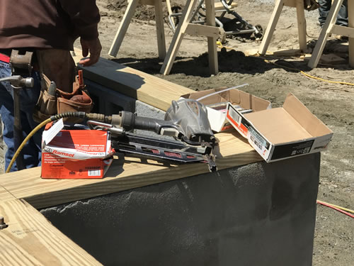 Pneumatic nail gun and boxes of nails - Building our Schumacher Home