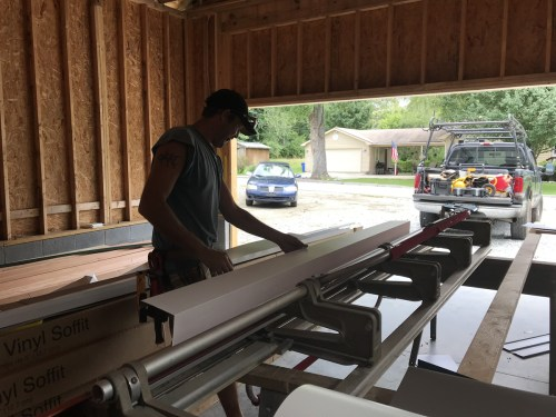 Siding brake to bend aluminum trim coil to create the fascia - Installing the Vinyl Siding - Building Our Schumacher Home - Project Small House