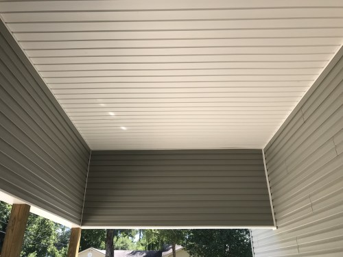 Ceiling in the carport - Installing the Vinyl Siding - Building Our Schumacher Home - Project Small House