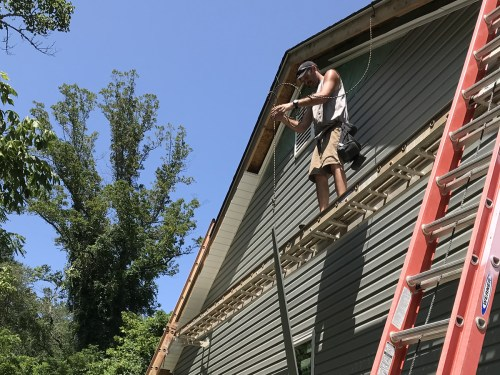Pulling up A Piece of Siding - Installing the Vinyl Siding - Project Small House