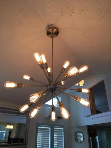 Mid-century Nice high ceiling with a Modern Atomic style chandelier - See Inside the Tardis Tiny House – Project Small House