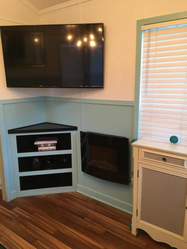 Flat Screen TV - I love the colors - See Inside the Tardis Tiny House – Project Small House