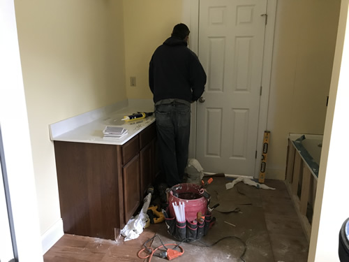 Putting on the side splash - Cultured Marble Vanity Tops and Tub Surround – Project Small House