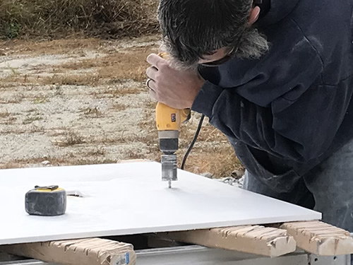 Drilling a hole for the spout - Cultured Marble Vanity Tops and Tub Surround – Project Small House
