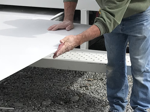 Sanding the edges of the tub surround - Cultured Marble Vanity Tops and Tub Surround – Project Small House