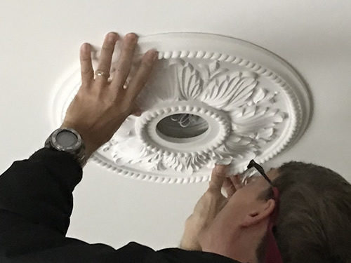 Sliding the medallion into place - Ceiling Medallions in the Dining Room and Entry – Project Small House