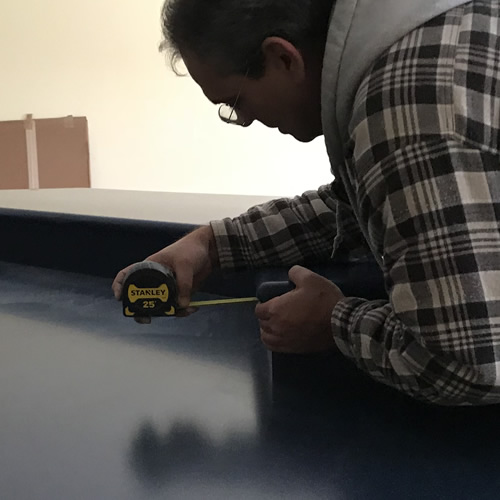 Measuring to be sure the bar is the same all the way around - Corian Countertops in the Kitchen - Schumacher Homes Cross Creek – Project Small House