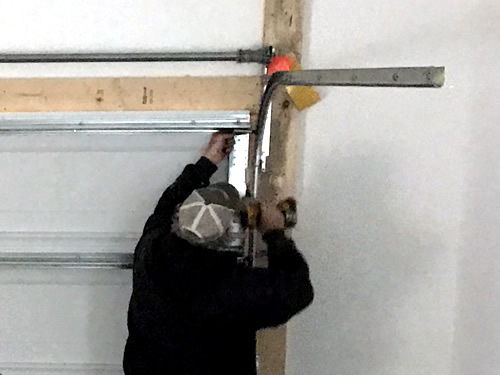 Adjusting the spring, I think - Garage Door – Building our Schumacher Home – Project Small House