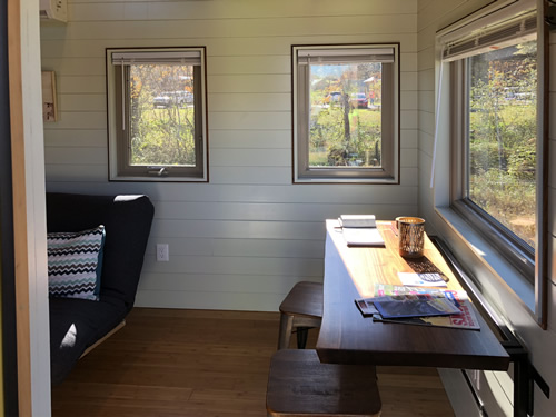 Eating area in this bright tiny house with ship-lap walls - More Photos from the Open House at Acony Bell Tiny Home Village – Project Small House