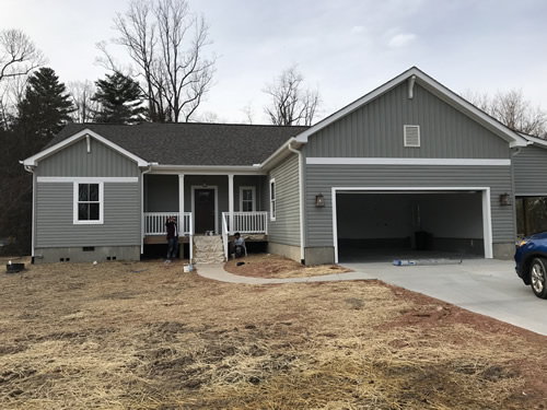 The weather is warm enough to finish painting the white trim on the house. - We have Power! Finishing Up – Building our Schumacher Home – Project Small House