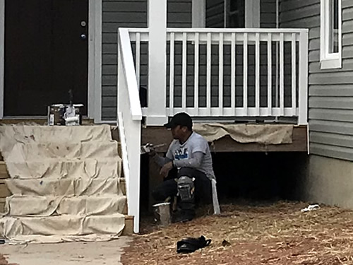 Painting the front porch columns and railings - We have Power! Finishing Up – Building our Schumacher Home – Project Small House