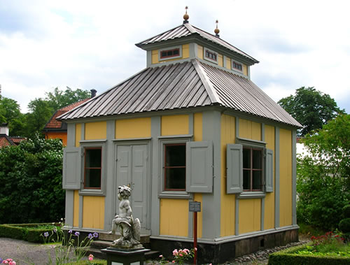 The Summer House is small, with lots of windows to let the light and breeze in. - Inspiration: Swedish Summer House