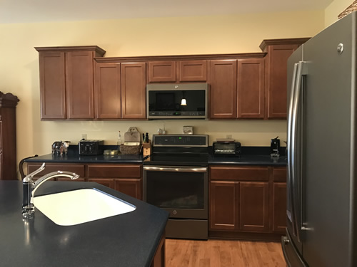 I notice a lot of clutter on the back counter. - Our New Kitchen - Getting Settled – Project Small House
