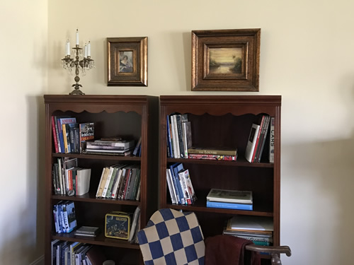 Putting away books and hanging paintings - Getting Settled and Enjoying Spring – Project Small House