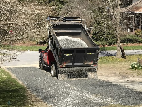 Second pass down the driveway - Tailgate Spreading Gravel at the Cabin