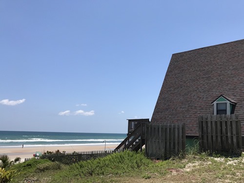 The roof, the beach and the stairs from the deck - A-Frame House on the Beach