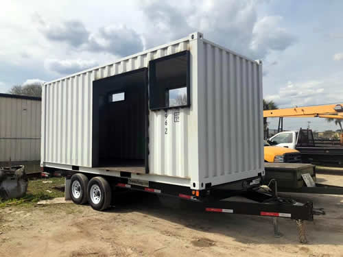 The container with the windows and doors opened up.