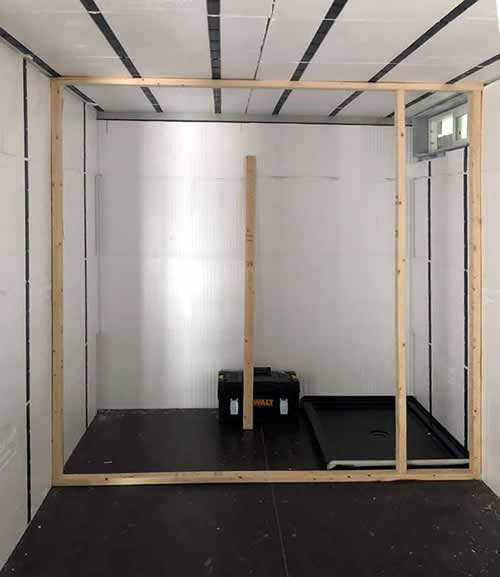 Framing the bathroom wall in a new container house