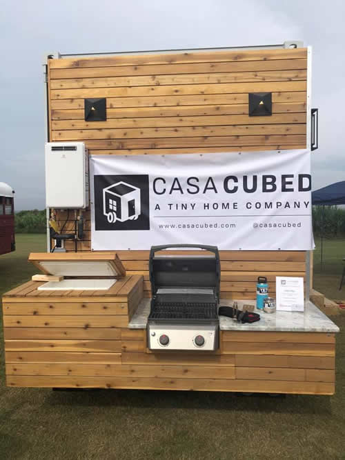 Outdoor Kitchen Ice Chest and Weber Grill built in on the back of a Casa Cubed Container House