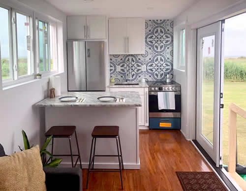 The open concept full kitchen has enough room to cook.