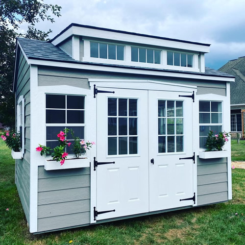 Small She Shed with Flower Boxes