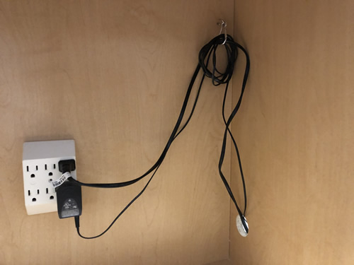 Outlet inside the cabinet, hole for power cords, hook and carabiner clip