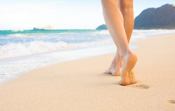 foot-on-the-beach-sand-sea