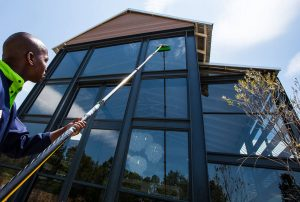 Man Cleaning Windows in Folsom Ca