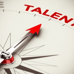 Navigational compass with hands pointing to talent for recruiting assistant property managers