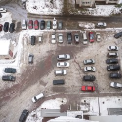 Apartment Parking Lot Covered In Snow For Multifamily Parking Policy Tips