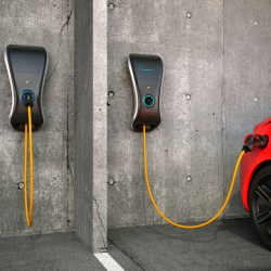 EV Charging Station Mounted To Parking Garage Wall Charging Car