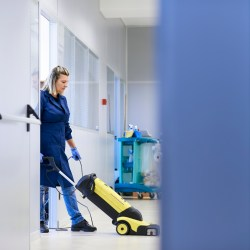 Woman Cleaning Commerical Floor For Green Cleaning Tips For Commercial Properties Blog