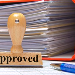 Approval Stamp And Binder After Building An Approved Contractor List