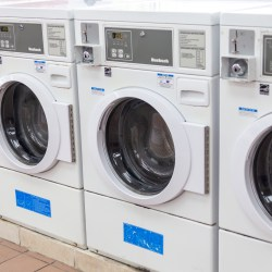 Stainless Steel Commercial Washing Machines With CoronaVirus In Multihousing Laundry Room