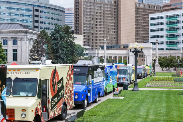 Line of Food Trucks Outside Apartment Complex For Property Managers And Food Trucks What You Need To Know Blog