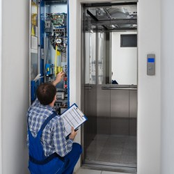 Professional Inspector Providing Commercial Elevator Inspection Services At An Office Property