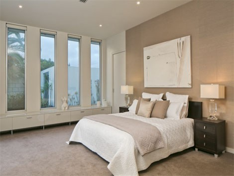 The master bedroom has direct access to the backyard.