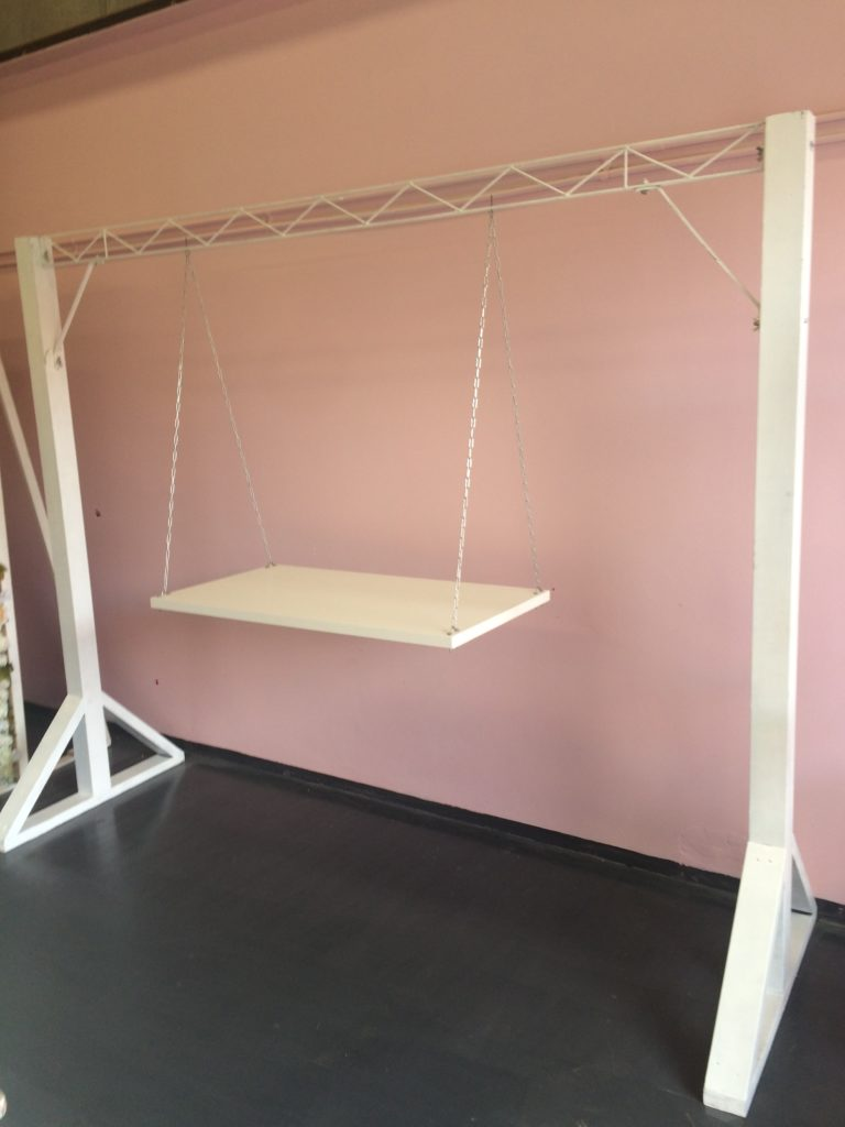 swing chair hire director covers brisbane white arbor with cake prop my party events