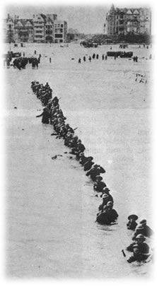 British Troops wade out to waiting rescue ships off Dunkirk.