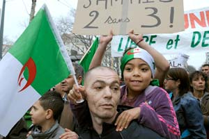 A young girl holds an Algerian national flag on Feb. 12, 2011 in Marseille during a demonstration after Egypt's regime change. (Photo credit: BORIS HORVAT/AFP/Getty Images)