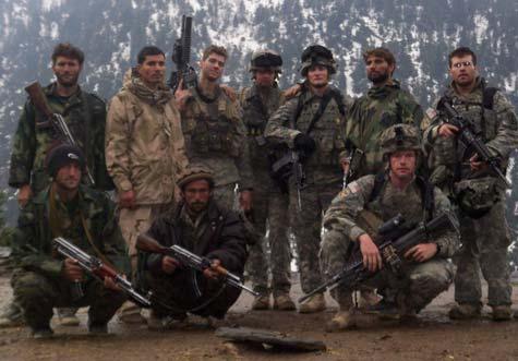 Farshad Yewazi (standing, far left in light camo), 23, was wounded during an ambush while serving as a translator for the U.S. Army in Afghanistan. His insurance company failed to provide him medical benefits.