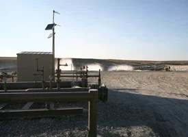 Misted waste fluid rises from waste pits at a Wyoming well site. (Credit: Abrahm Lustgarten/ProPublica)
