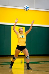 Photo by Scott Wells/Prospectus News Sophomore Setter Morgan Hickman serves during the first set of the Sept. 10, 2014 match against Lewis and Clark Community College. The Cobras defeated the Trailblazers in three sets, improving their record to 14-1.