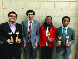 Photo by Brian Cafarelli | Parkland College Left to right: Nick Scott, Ethan Young, Mario Flemming and Eric Miller stand with their awards after the Illinois Intercollegiate Forensics Association State Tournament on Saturday, March 7, 2015.