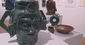 """Photos by David Saveanu   Ceramics 1 student Aspen McGehee's piece """"Moon Goddess"""" is seen in front of other students' works at the Giertz Gallery."""