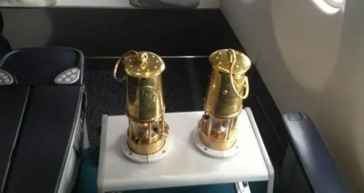 A photograph of two of the  heat resistant miners' lamps carrying the eternal flame on an Aer Lingus transatlantic flight. Photograph: Mark Little via Twitter